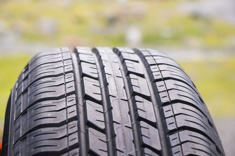 Close-up of tire against blurred background