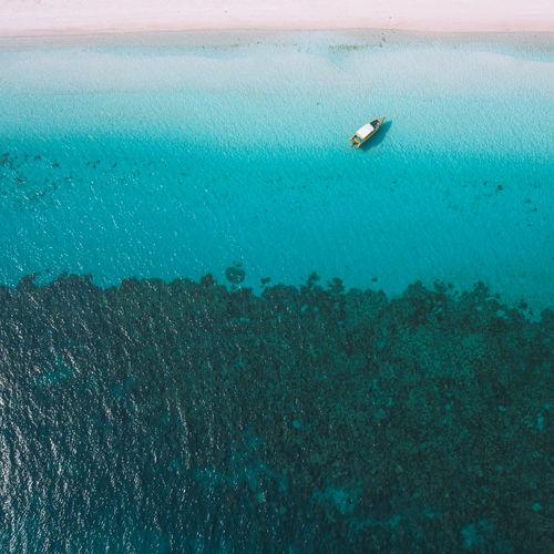 Drifting boat at sea.