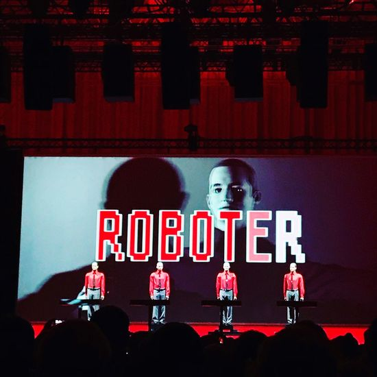 Kraftwerk Real People Red Illuminated Text Night Large Group Of People Men Leisure Activity Architecture Indoors  People
