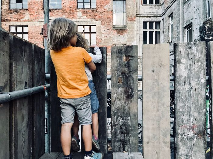 Rear view of boy on wall