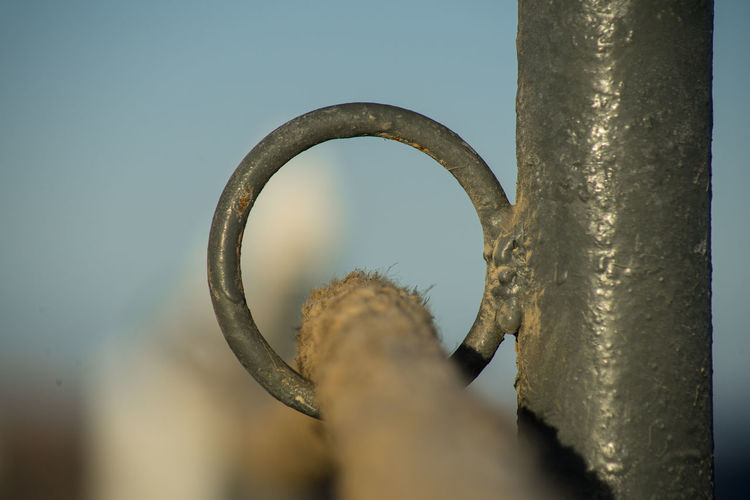 Close-up of rusty metal against sky
