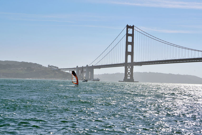Sailing Past The Golden Gate Bridge 6 Windsurfer Windsurfing Sailboat Ferry Sailing San Francisco Bay Golden Gate Bridge South Anchorage Fort Point Silhouettes Hills Of San Francisco Eastbay Hills Seascape Landscape_Collection Landscape_photography Bridge Architecture Bridge Tower & Span A Day On The Bay Enjoying Life Nature Nature_collection Beauty In Nature Riding The Winds Water Sport Horizon Over Water Wake - Water Coast