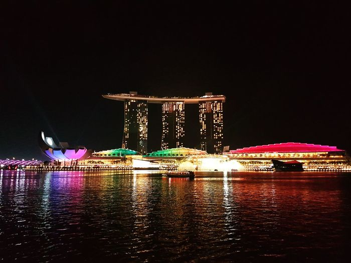 Marina Bay Sands at night.😍 Illuminated Night Architecture Reflection Cityscape Travel Singapore Wanderer Lightshow Illuminated Night Architecture Built Structure Building Exterior Water City Skyscraper Waterfront Travel Destinations Modern Marina Bay Sands Reflection Tourism Sea