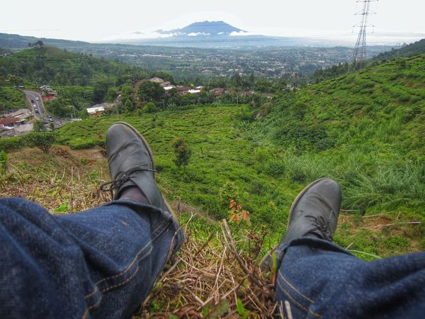 Low Section Personal Perspective Human Body Part Human Leg Grass Real People Green Color One Person Relaxation Shoe Leisure Activity Lifestyles Outdoors Scenics Tranquil Scene Landscape From My Point Of View POV First Person View Adventure Trekking On A Hill Rural Landscape Miles Away
