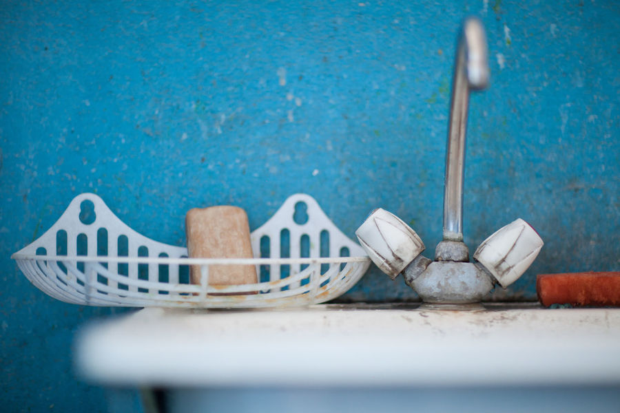 Beach Water Blue Day Outdoors Swimming Pool No People Still Life Table Wood - Material Close-up Indoors  White Color Selective Focus Wall - Building Feature Eating Utensil Kitchen Utensil Spoon Food Food And Drink Focus On Foreground Group Of Objects Household Equipment Built Structure Turquoise Colored The Modern Professional