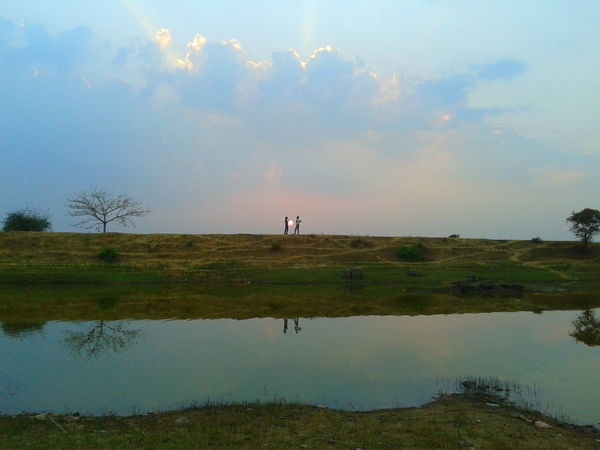 Architecture Beauty In Nature Day Distance Grass Landscape Nature Outdoors Reflection Scenics Sky Sunset Tranquil Scene Tree Water