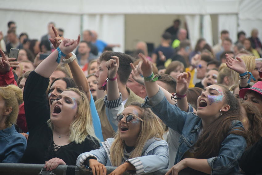 Tidal Waves pop festival, 10th June 2017 Arms Raised Arts Culture And Entertainment Celebration Cheerful Cheering Crowd Day Enjoyment Excitement Focus On Foreground Fun Happiness Human Arm Human Body Part Human Mouth Large Group Of People Leisure Activity Lifestyles Mouth Open Real People Screaming Shouting Togetherness Young Adult Young Women