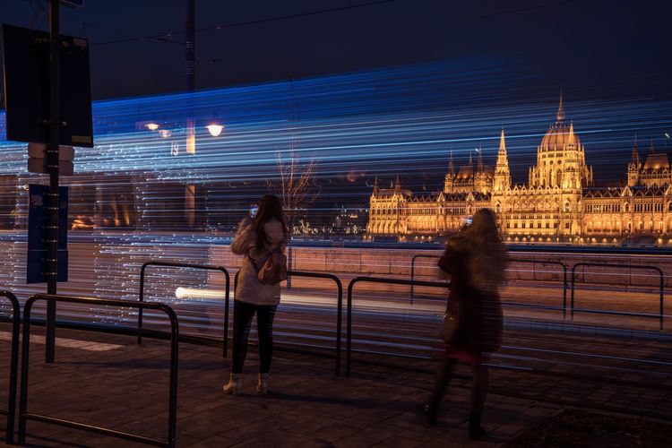Quickie Christmas Christmastime Long Exposure Budapest Magyarország Hungary Illuminated Night Architecture Real People Built Structure Building Exterior City Standing Women Outdoors People Group Of People