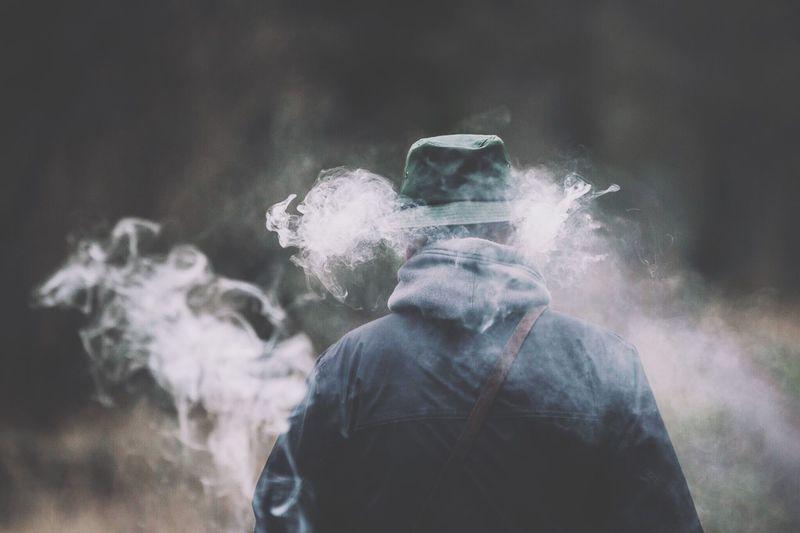 Rear view of man amidst smoke