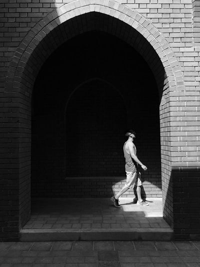 Towards the light Blackandwhite Photography Arch Full Length Architecture Real People One Person Built Structure The Street Photographer - 2018 EyeEm Awards