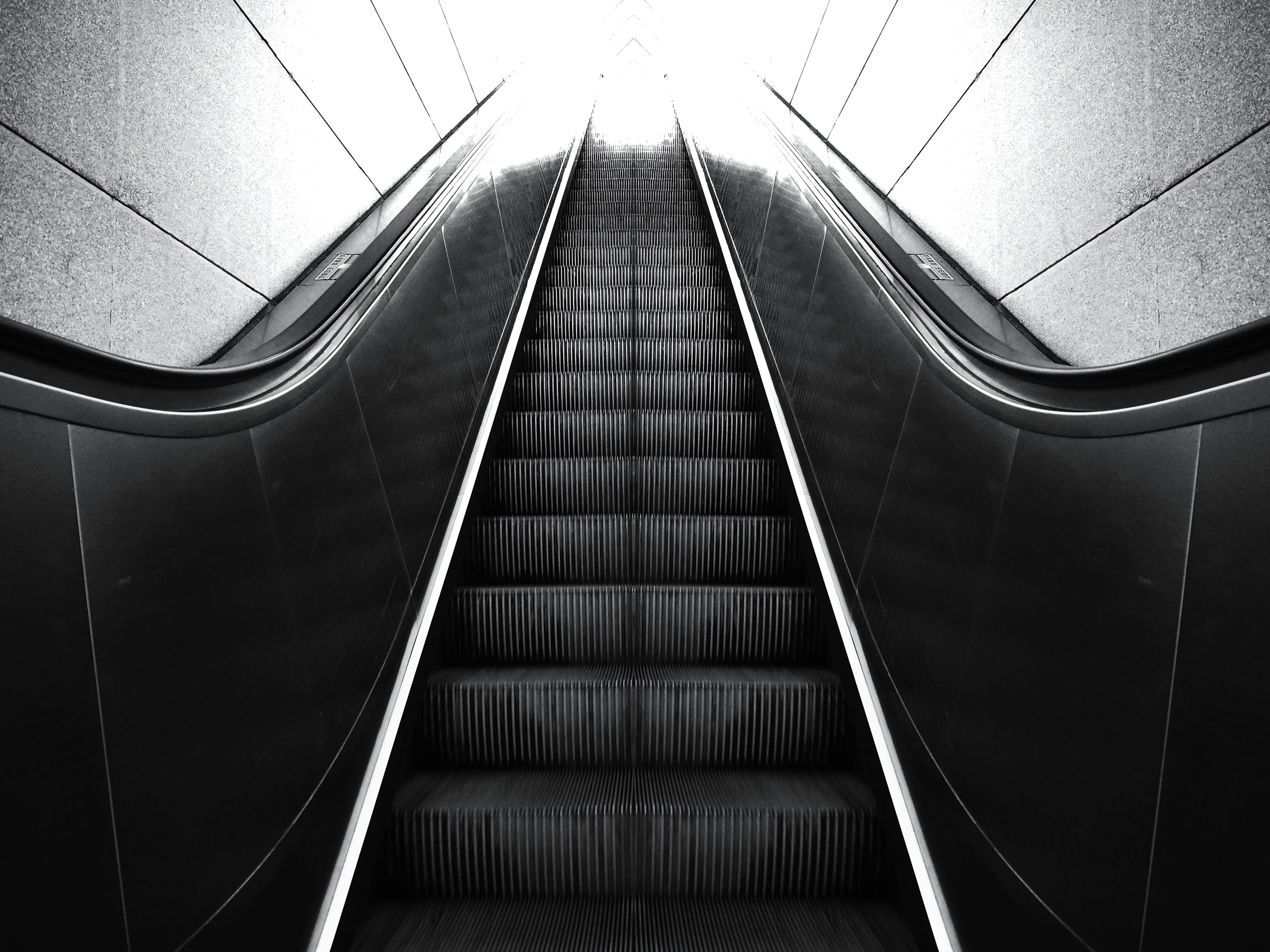 transportation, the way forward, escalator, diminishing perspective, vanishing point, steps and staircases, low angle view, steps, indoors, railing, modern, high angle view, staircase, built structure, day, architecture, no people, pattern, travel, technology