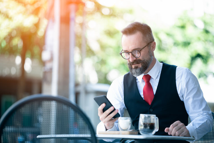 Man using mobile phone on table