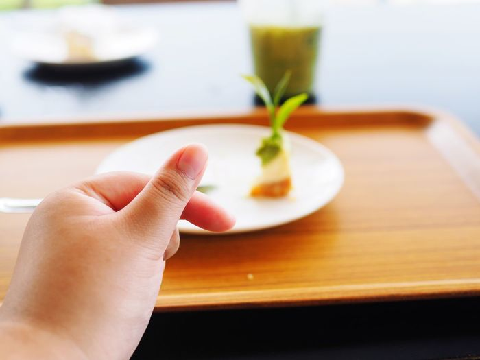 EyeEm Selects Human Hand Hand Human Body Part One Person Body Part Real People Food Human Finger Focus On Foreground Lifestyles Freshness Holding Table Close-up Indoors  Unrecognizable Person Finger Food And Drink Adult