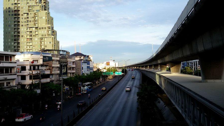 Multiple Lane Highway By Buildings Against Sky In City