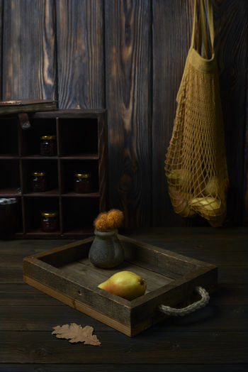 Absence Container Domestic Room Drawer Food Food And Drink Freshness Fruit Furniture Healthy Eating Indoors  No People Pearls Still Life String Bag Table Wellbeing Wood Wood - Material Wood Grain Yellow