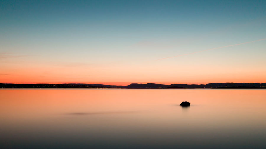 After sunset in the Oslo fjord. Sunset Water Tranquility Waterfront Idyllic Nature Non-urban Scene No People Outdoors Beauty In Nature Tranquil Scene Orange Color Scenics - Nature Long Exposure Evening Twilight Clear Sky Peace Lights Seascape Landscape Nordic Light Oslo Norway EyeEmNewHere
