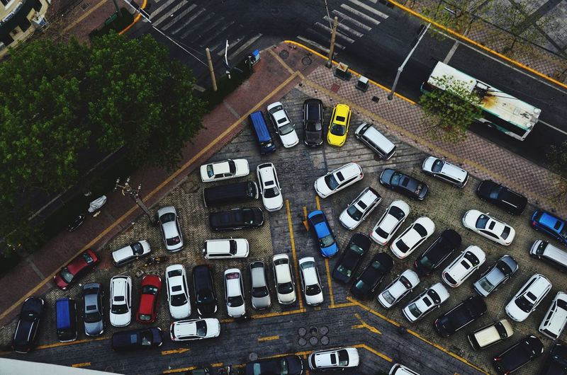 High angle view of cars parked at parking lot