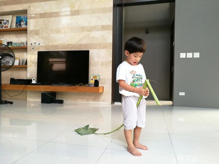 Full Length Child One Person Childhood Lifestyles People Baby Babies Only Cheerful Indoors  Day Banana Leaf Kid Boy Play Antique