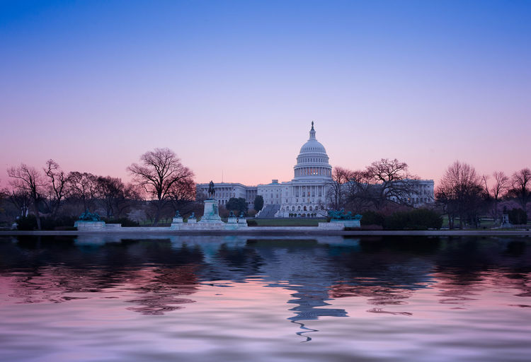 Sunrise at the US Capitol building in the capital city of Washington DC in the USA Capitol DC Government Reflection Skyline US Capitol US Capitol Building USA Washington Washington DC Washington, D. C. Capital Congress Dawn Dome Government Lake Pool Sunrise Waterfront