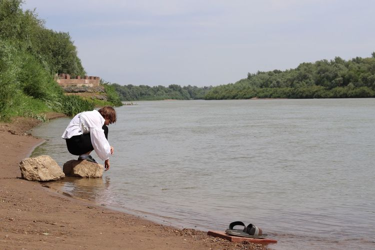 The Ural River Eos77D Canon Uralsk Kazakhstan Uralriver Water Real People Tree Day Lifestyles Sky Nature Leisure Activity One Person Beach Non-urban Scene Beauty In Nature Casual Clothing Outdoors The Photojournalist - 2018 EyeEm Awards