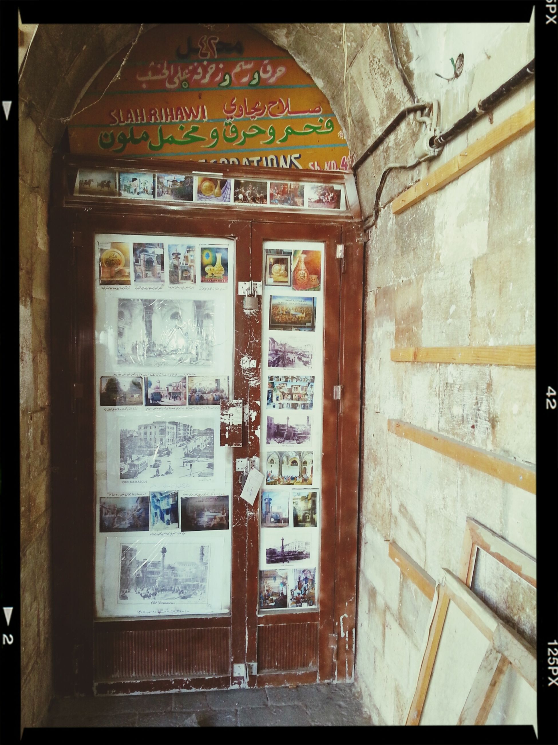 text, western script, communication, indoors, transfer print, non-western script, old, architecture, auto post production filter, built structure, door, information, no people, wood - material, number, wall - building feature, closed, day, old-fashioned, wall