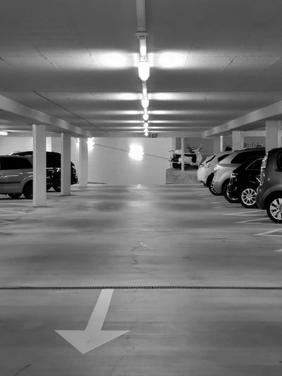 Black & White Architectural Column Architecture Black And White Built Structure Car Ceiling Garage Illuminated Indoors  Land Vehicle Light And Shadow Lighting Equipment Marking Monochrome monochrome photography Motor Vehicle No People Parking Parking Garage Parking Lot Road Marking Sign Transportation