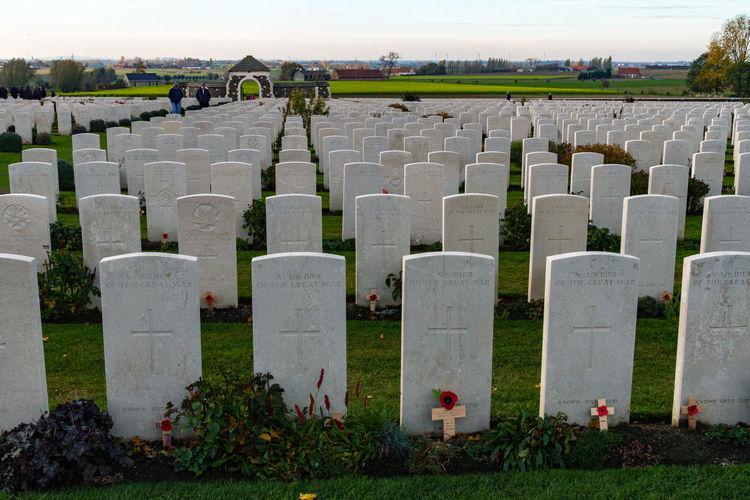 Row of cemetery against the sky