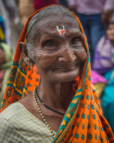 portrait The Street Photographer - 2019 EyeEm Awards The Portraitist - 2019 EyeEm Awards Streetphotography Streetlife Holi Portrait City Sari Smiling Human Face Turban Traditional Festival Religion Looking At Camera Nose Ring Pierced