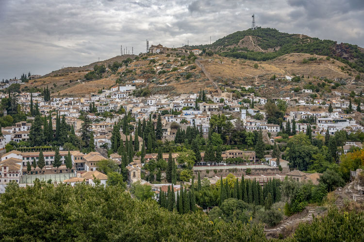 GRANADA, SPAIN - October 11, 2018: The famous Alhambra in Granada, Spain. It is a palace and fortress complex located in Granada. Granada SPAIN Alhambra Alhambra De Granada  Architecture Arabic Style Ancient Architecture Mosque Architecture Interior Design Built Structure Building Exterior Plant City Building Sky Nature Residential District No People Cloud - Sky Outdoors Town Environment Mountain Cityscape TOWNSCAPE