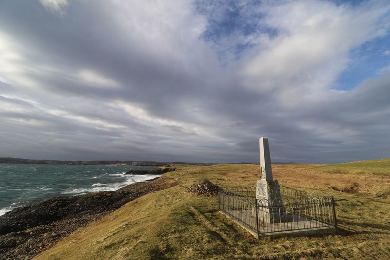 Scottish History Sunken Ship Shipping Tragedy War Memorial Stornoway Scotland Cloud - Sky Sea Sky Water Built Structure Railing Nature Horizon Over Water Grass Beauty In Nature No People Outdoors Architecture Tranquility Scenics Beach