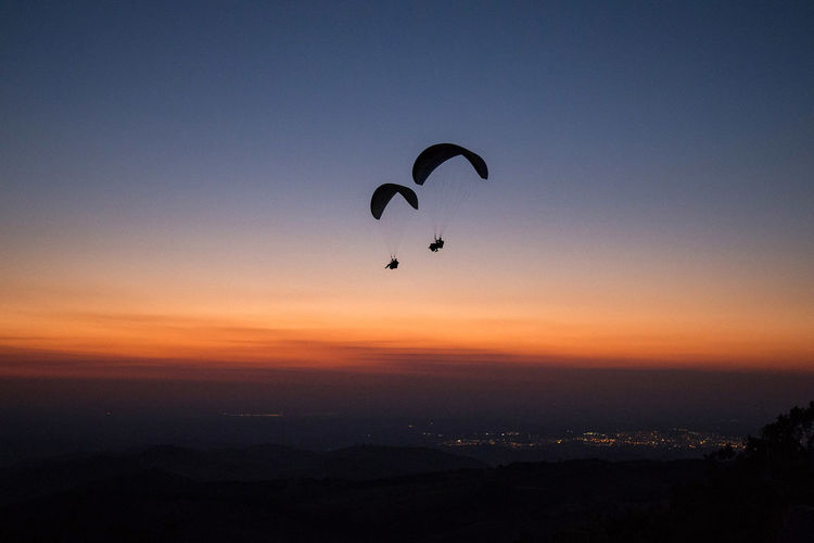 Paragliding over beautiful sunset. Blue Sky Day Outdoors Paraglider Paragliding Silhouette Sky Sunset