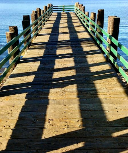 Bonelli Outdoors Shadow Railing Sunlight Pier Day Nature Sea No People Water Wood Paneling Sunny Beauty In Nature Illuminated Above High Angle View Low Angle View Sky Lifestyles Adult Cloud - Sky Los Angeles, California Streetphotography Nature Growth