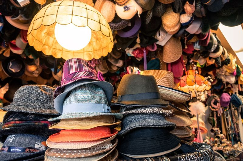 Close-up of colorful hats for sale at market
