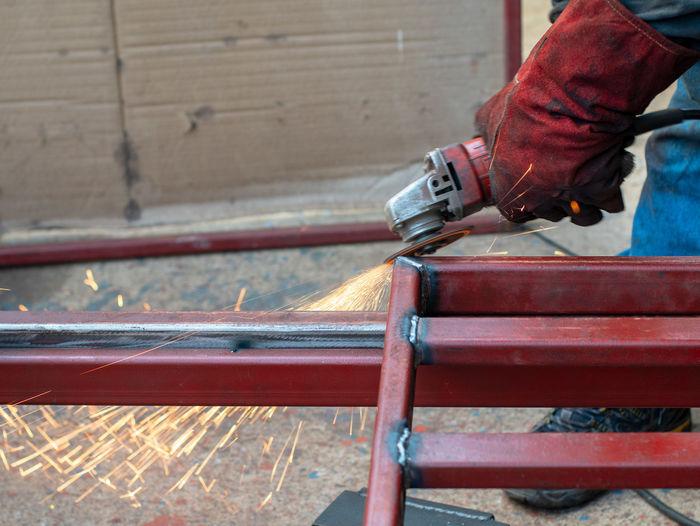 Close-up of worker welding metal