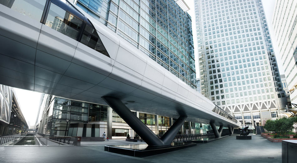 A picture of the skyscrapers in Canary Wharf taken early in the morning. In the shot is one Canada square and the new Crossrail station entrance. Awesome Bank Beautiful Canary Wharf Check This Out City Cityscape Cool Desaturated England Europe Glass Light London Panorama Perspective Reflection Skyscraper Uk Wide Angle