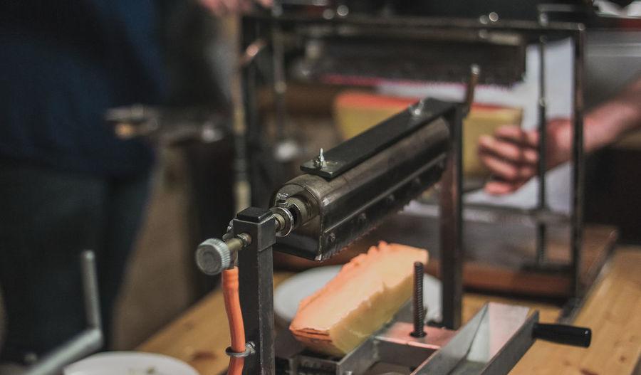 Close-up of man working at machine