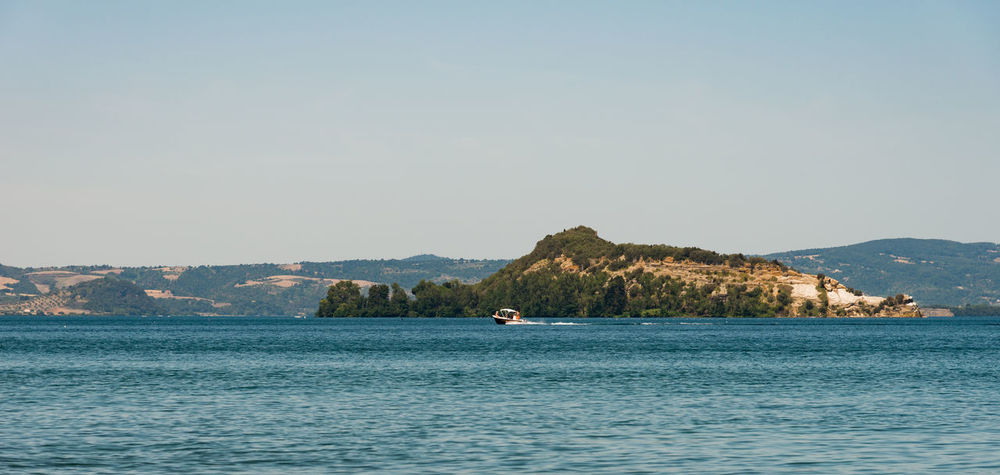Isola Martana - Lago di Bolsena Beauty In Nature Clear Sky Day Mountain Nature One Man Only One Person Only Men Outdoors Paddleboarding People Scenics Sea Sky Tranquil Scene Tranquility Tree View Into Land Water Waterfront
