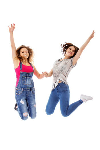 Happy young woman jumping against white background