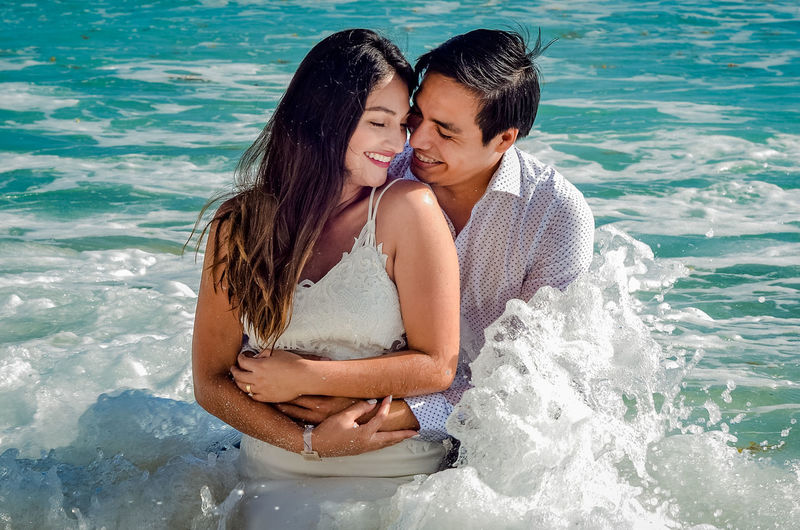Portrait of couple kissing in sea