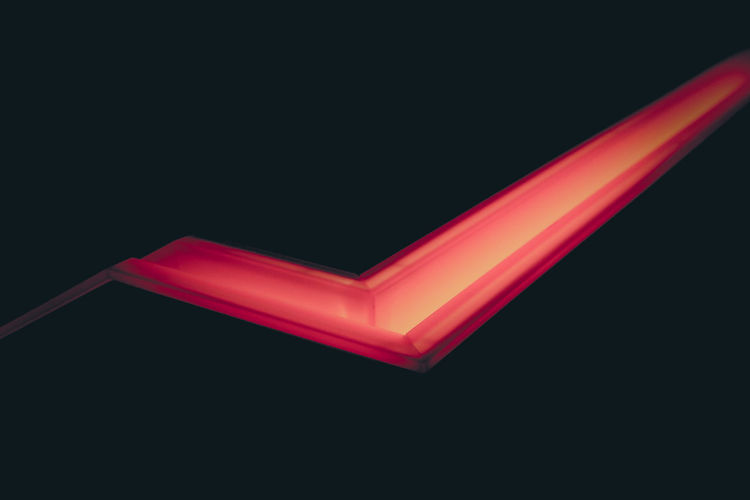 Illuminated light over colored background