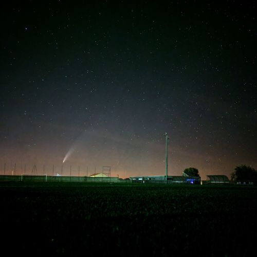Scenic view of field against sky at night