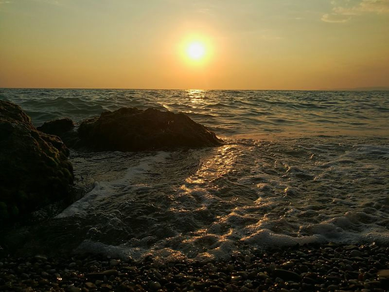 Sunset Water Beauty In Nature Tranquility Orange Color Sky Seascape Wave Colour Of Life Sicilia Bedda Nature Sicily, Italy Golden Moments  Colors Of Nature Sea Life Sea And Sky Lovethisview Travel Destinations Goldlight Golden Moment Colors Freedom Water Reflections Rocks And Water Rocks