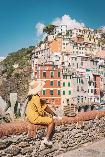 Riomaggiore Cinque Terre Cinqueterre Liguria Liguria,Italy Woman Sunset Girl Dress Vacations EyeEm Selects City Men Sitting Sky Architecture Travel Coast Tourist Tourism Tourist Attraction  Beach Holiday Civilization Archaeology Visiting