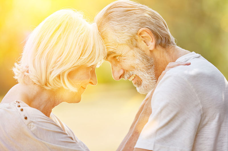 Close-Up Of Smiling Couple With Face To Face In Sunny Day