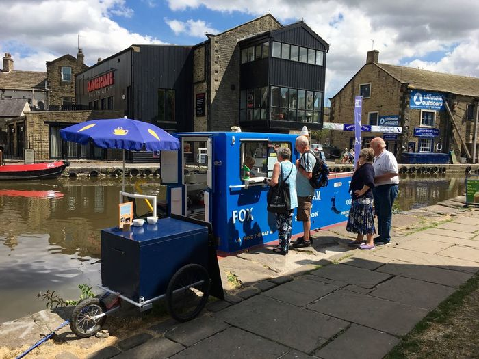 Ice cream shop barge on the Leeds Liverpool canal in Skipton, Yorkshire Ice Cream United Kingdom England Skipton Town Lifestyle Peaceful Transport Barge Leeds Liverpool Canal Yorkshire Canal Boat Towpath Architecture Building Exterior Real People Built Structure Sky Cloud - Sky Day Lifestyles People Transportation Mode Of Transportation Outdoors