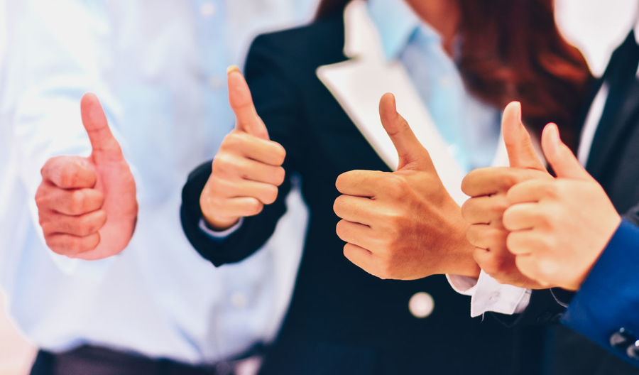 Human Hand Gesturing Hand Human Body Part Communication Finger Thumb Thumbs Up Hand Sign Focus On Foreground Human Finger Body Part Men Adult Business Showing Technology Indoors  Real People Business Person