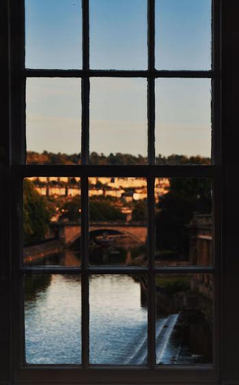 Framed. Sunset Cityscape City Window Reflection Sky Cloud - Sky Close-up Window Frame Window Sill Looking Through Window Glass - Material Tranquil Scene Idyllic Scenics Transparent Dusk Calm