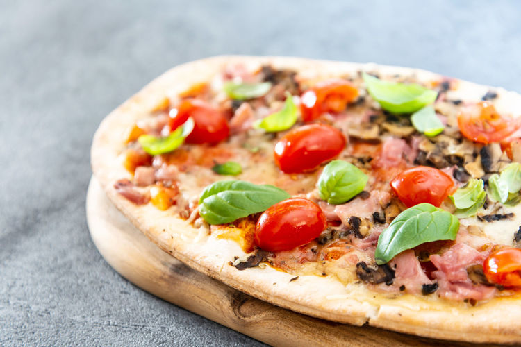Close-up of pizza on serving board