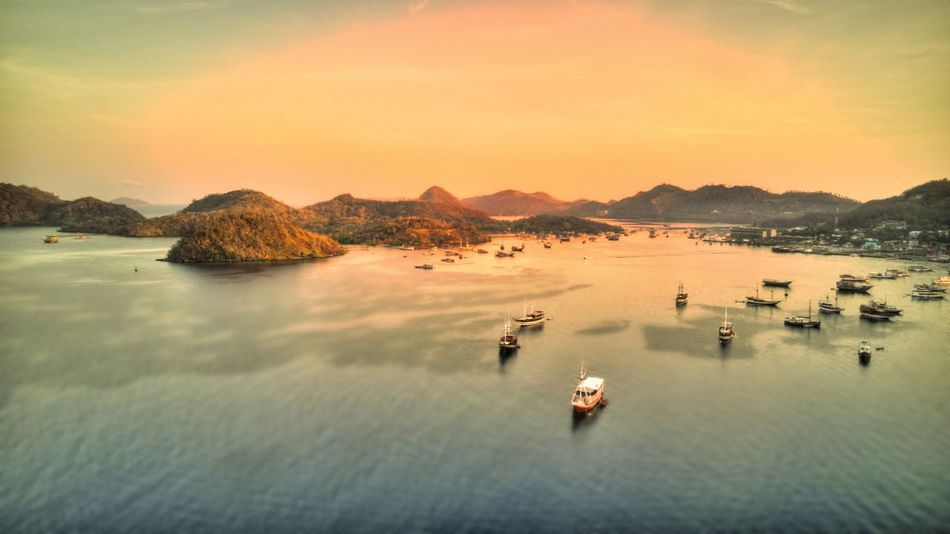 Labuan Bajo Labuan Bajo Flores INDONESIA Aerial View Aerial Photography Drone Shot Water Sky Mountain Sea Beauty In Nature Sunset Nature Nautical Vessel Scenics - Nature Transportation Tranquility Mode Of Transportation Cloud - Sky No People Tranquil Scene Land Bay Beach Outdoors Mountain Range