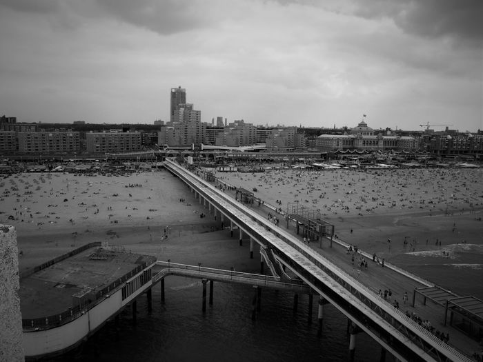 High angle view of people on pier at beach in scheveningen